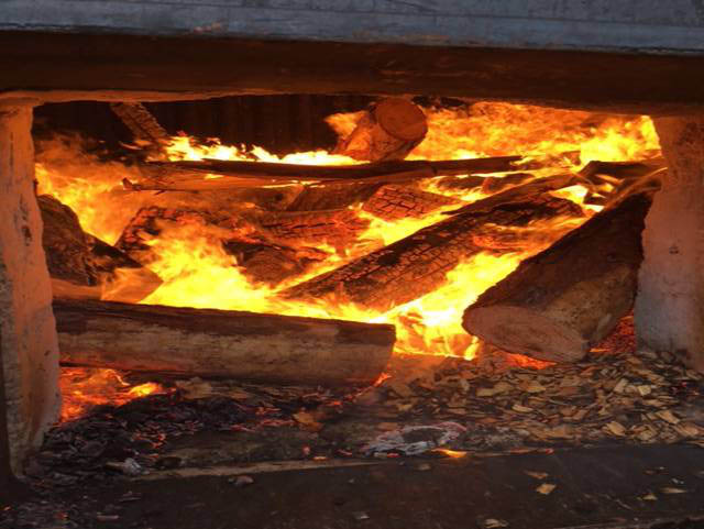 Wood burning in wood fired boiler