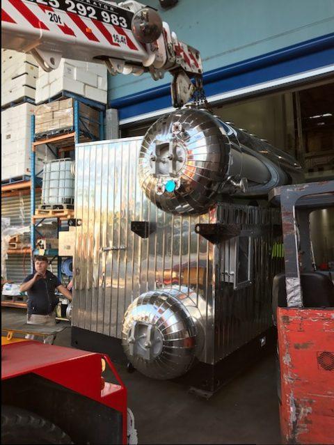 crane lifting now boiler